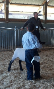 Nephew Kevin, his grand champion market lamb and the judge.
