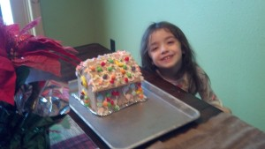 Ellie and her gingerbread house.